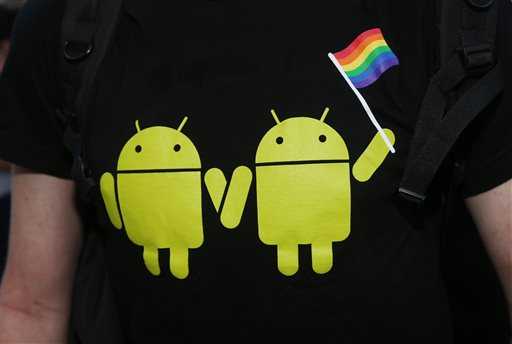 A supporter of gay rights wears a shirt bearing the likeness of two Android robots carrying a rainbow flag at a protest outside the Federal Courthouse in downtown Denver.
