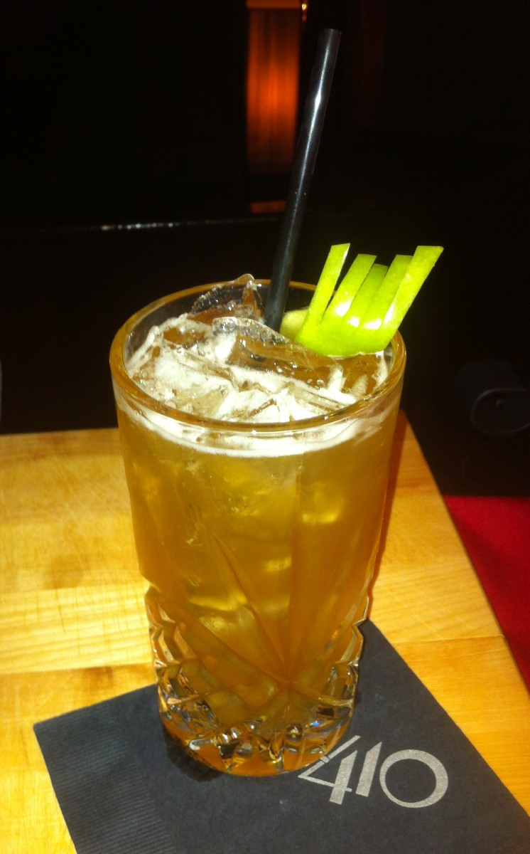 "Suite 410 Bar has created ""The Beastronessey"", which combines Marshawn Lynch's two favorite spirits, Hennessey and Patron, with yellow chartreuse, apple juice, maple syrup and a Granny Smith apple garnish. The Beastronessey will be served at Suite 410 through Super Bowl Sunday. (Image: Tommy Stearns)"