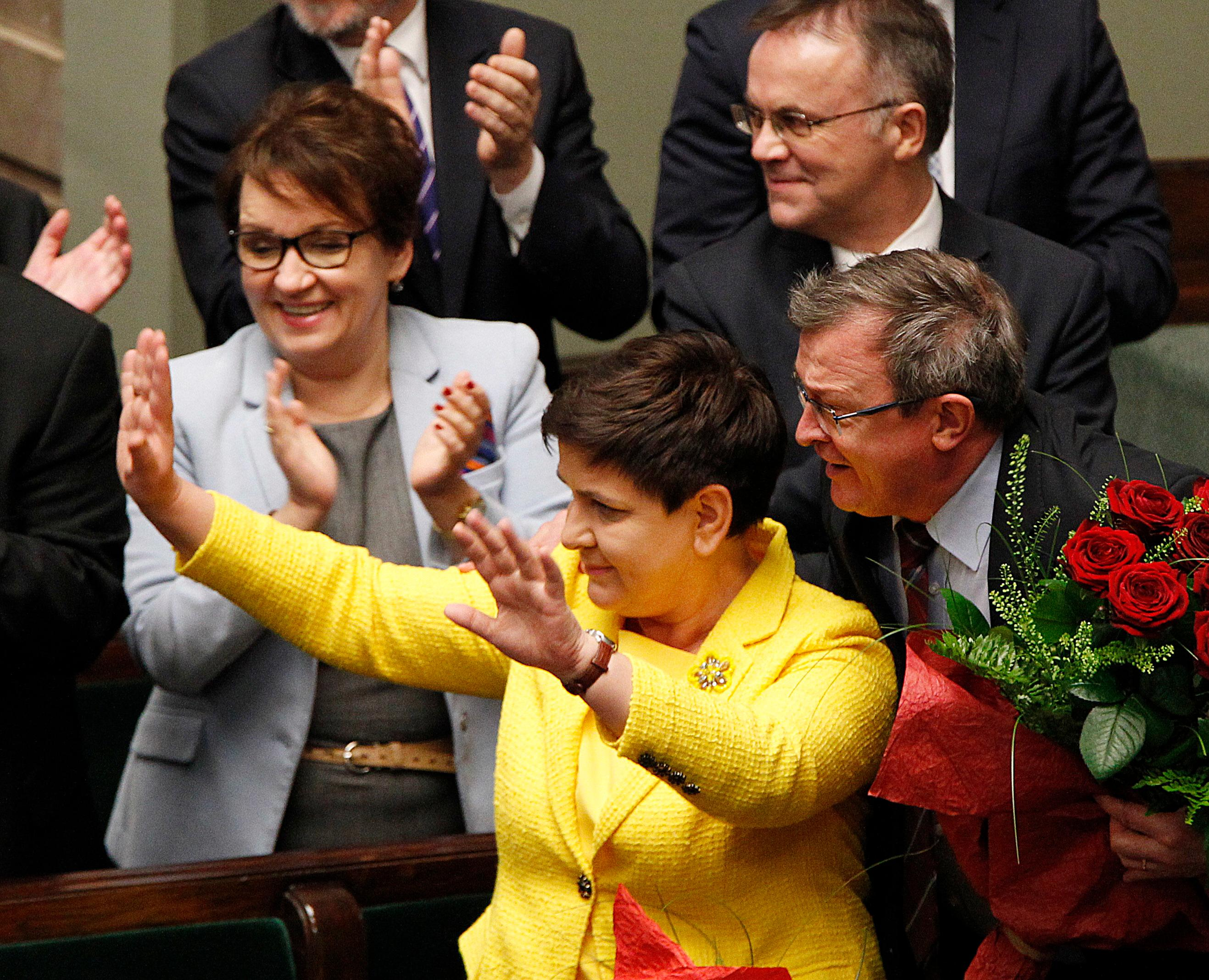Poland's Prime Minister Beata Szydlo, left, rejoices after she and her government survived opposition's vote of no-confidence in the parliament in Warsaw, Poland, Thursday, Dec. 7, 2017. Szydlo, however, is at the center of speculation that she and some of her ministers will be replaced in a government reshuffle in the near future. (AP Photo/Czarek Sokolowski)