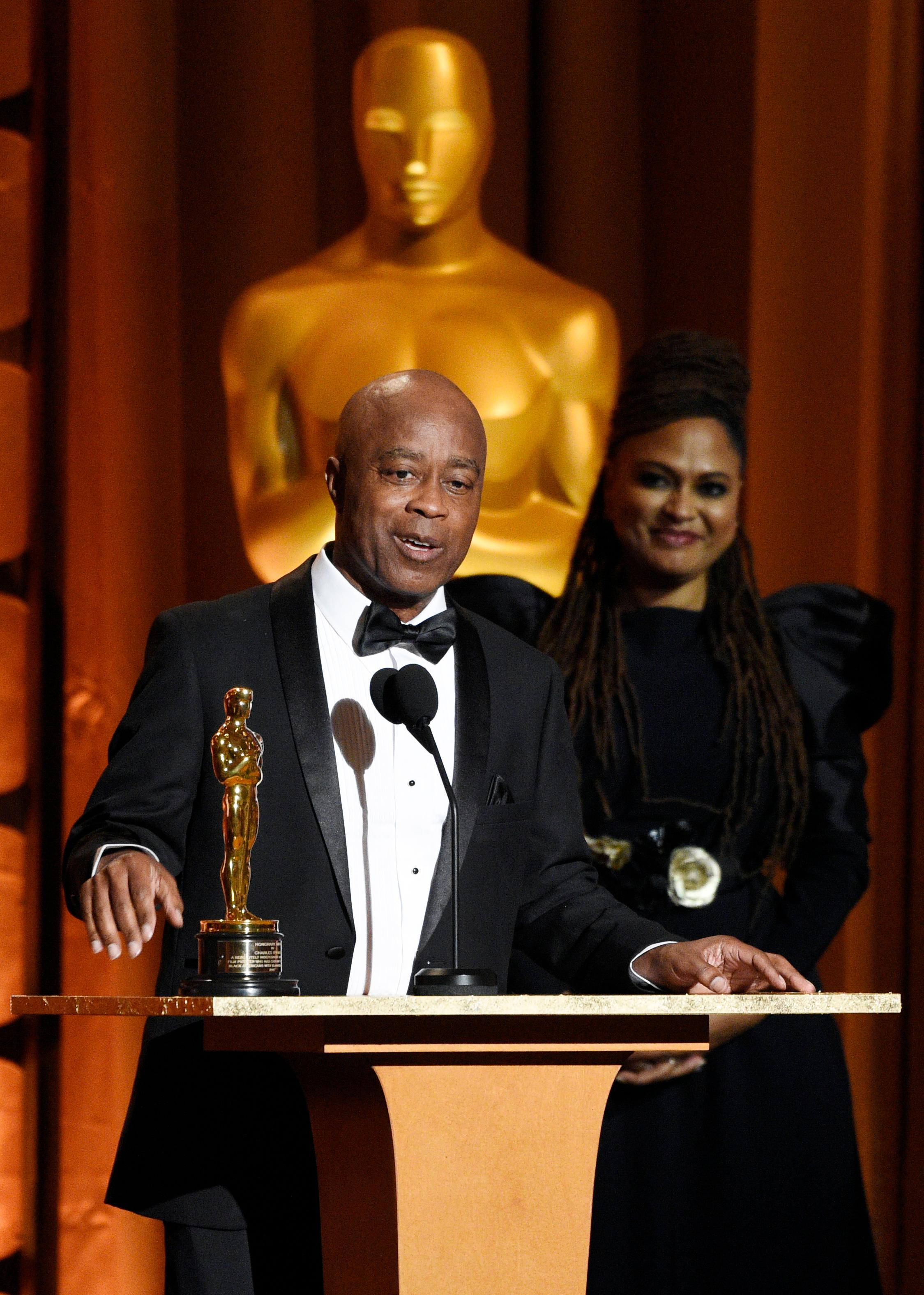 Film director Charles Burnett accepts an honorary Oscar as presenter Ava DuVernay looks on at the 2017 Governors Awards at The Ray Dolby Ballroom on Saturday, Nov. 11, 2017, in Los Angeles. (Photo by Chris Pizzello/Invision/AP)