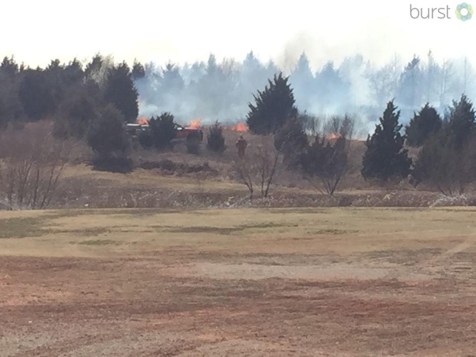 A grass fire burns March 15 near N. Kelley and Hefner in Oklahoma City. (KOKH/Scott Noland)