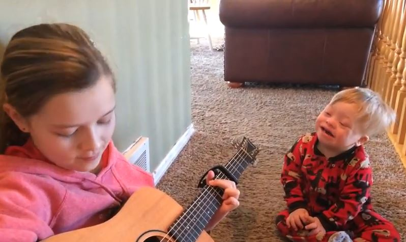 Lydia Gray, 12, and Bo Gray, 2, sing &quot;You Are My Sunshine&quot; in a video posted yesterday that is gaining attention and unintended awareness to Down syndrome. (Photo: Amanda Gray / YouTube)<p></p>