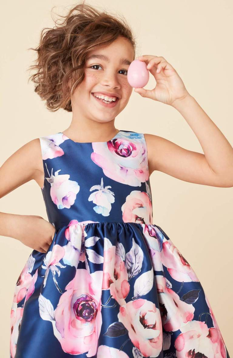 How sweet is this! Painterly roses shower a pretty party dress with soft color, but it's the full, gathered skirt she'll love the best. Price: $46 at Nordstrom (Image: Nordstrom){ }