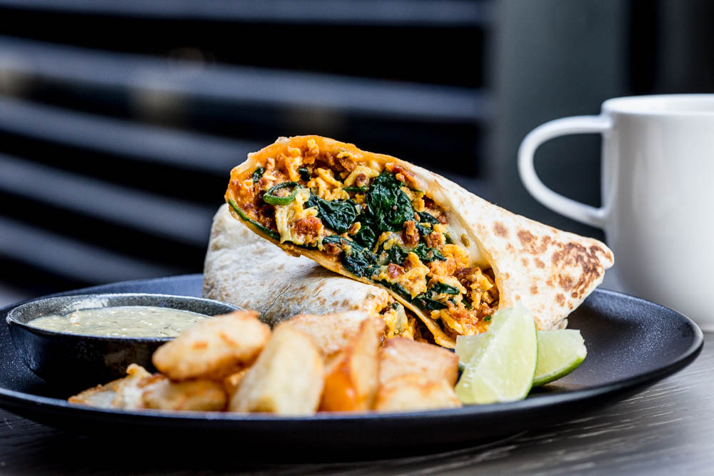 After a night of embracing your own dirty habits, recover with the brunch burrito, filled with scrambled eggs, chorizo, sautéed mushrooms and spinach, and salsa verde ($15). (Image: Courtesy Dirty Habit)
