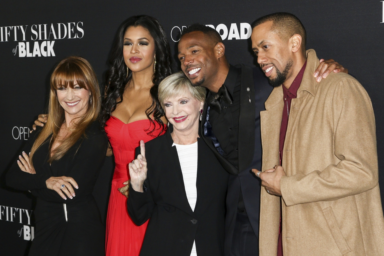 "FILE - In this Jan. 26, 2016 file photo, Jane Seymour, from left, Kali Hawk, Florence Henderson, Marlon Wayans and Affion Crockett attend the LA Premiere of ""50 Shades of Black"" held at Regal L.A. Live, in Los Angeles. Henderson, the wholesome actress who went from Broadway star to television icon when she became Carol Brady, the ever-cheerful mom residing over ""The Brady Bunch,"" has died at age 82. She died surrounded by family and friends, her manager, Kayla Pressman, said in a statement late Thursday, Nov. 24, 2016. (Photo by John Salangsang/Invision/AP, File)"