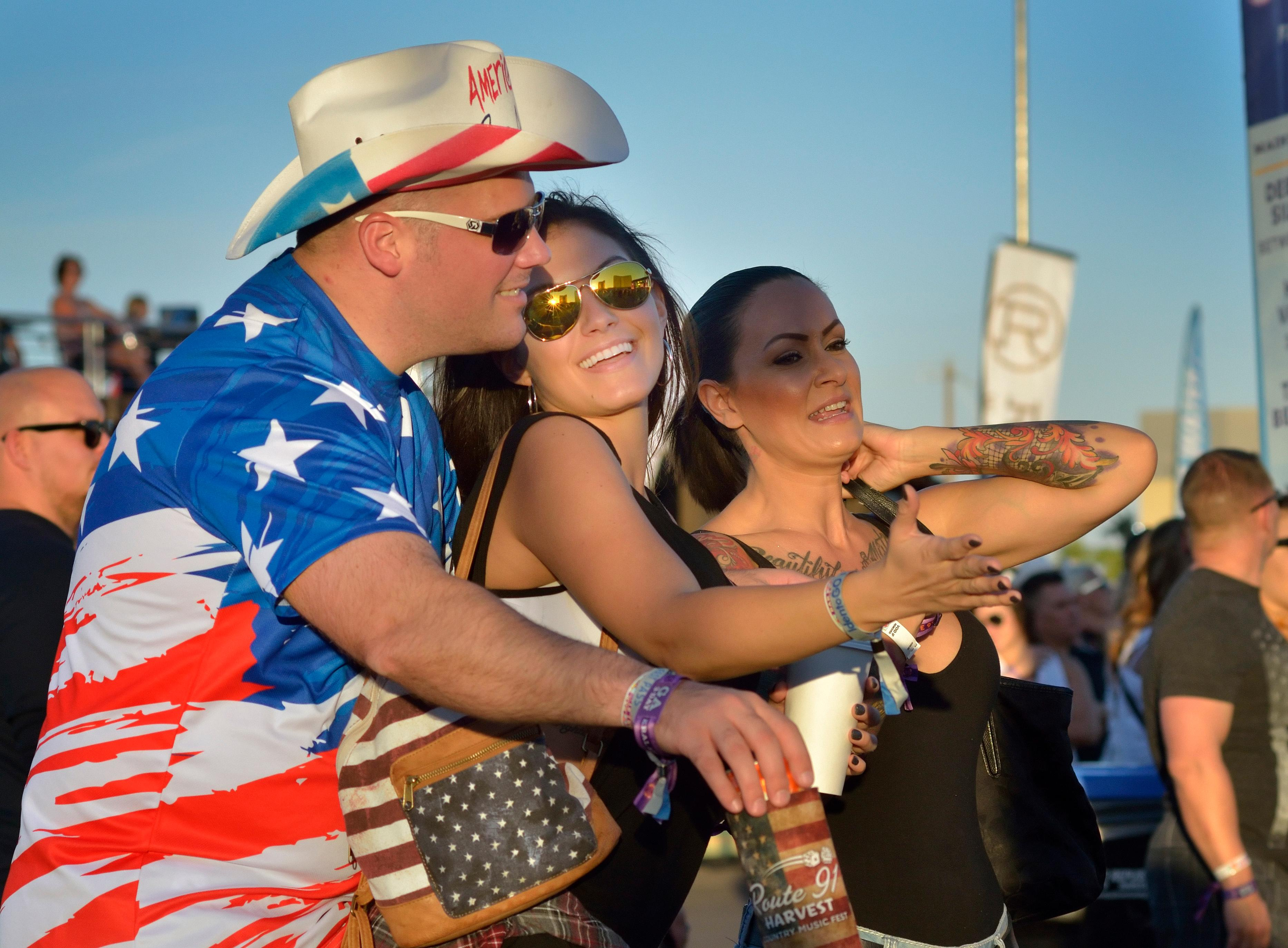 Stuart Smith, left, Ariana Gennaro, center, and Rena Powers dance during the Route 91 Harvest festival on Las Vegas Boulevard South in Las Vegas on Saturday, Sept. 30, 2017.  [Bill Hughes/Las Vegas News Bureau]