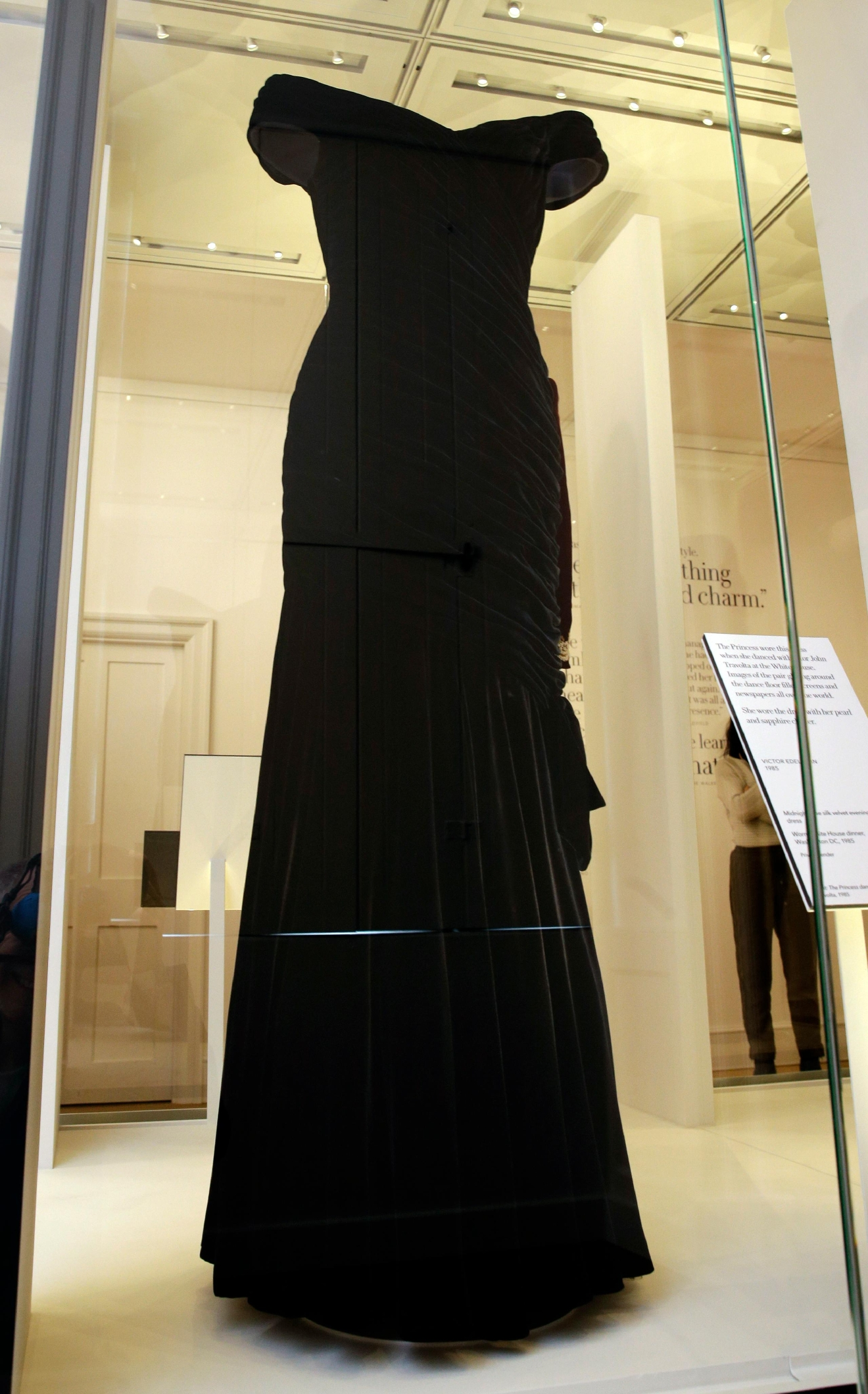 "A Victor Edelstein dress in midnight blue silk velvet, worn by Diana Princess of Wales at a State Dinner at the White House in 1985, on display during a media preview of an exhibition of 25 dresses and outfits worn by Diana, Princess of Wales entitled ""Diana: Her Fashion Story"" at Kensington Palace in London, Wednesday, Feb. 22, 2017. (AP Photo/Alastair Grant)"