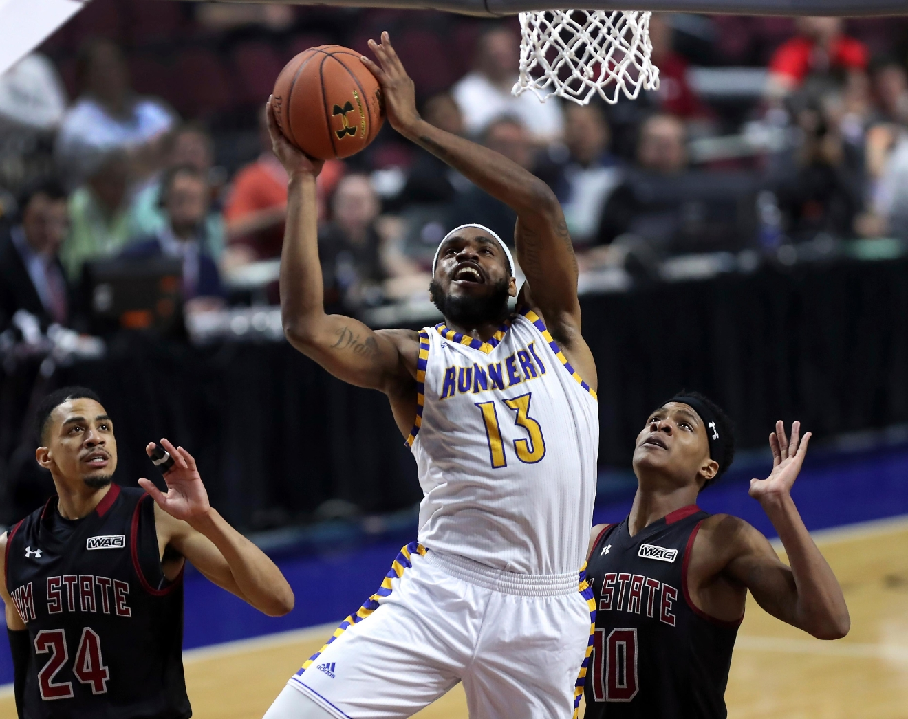 Cal State Bakersfield guard/forward Shon Briggs (13) sets up a shot between New Mexico State guard Matt Taylor (24) and forward Jemerrio Jones (10) during the first half of their NCAA college basketball game in the final of the Western Athletic Conference tournament on Saturday, March 11, 2017, in Las Vegas. (AP Photo/L.E. Baskow)