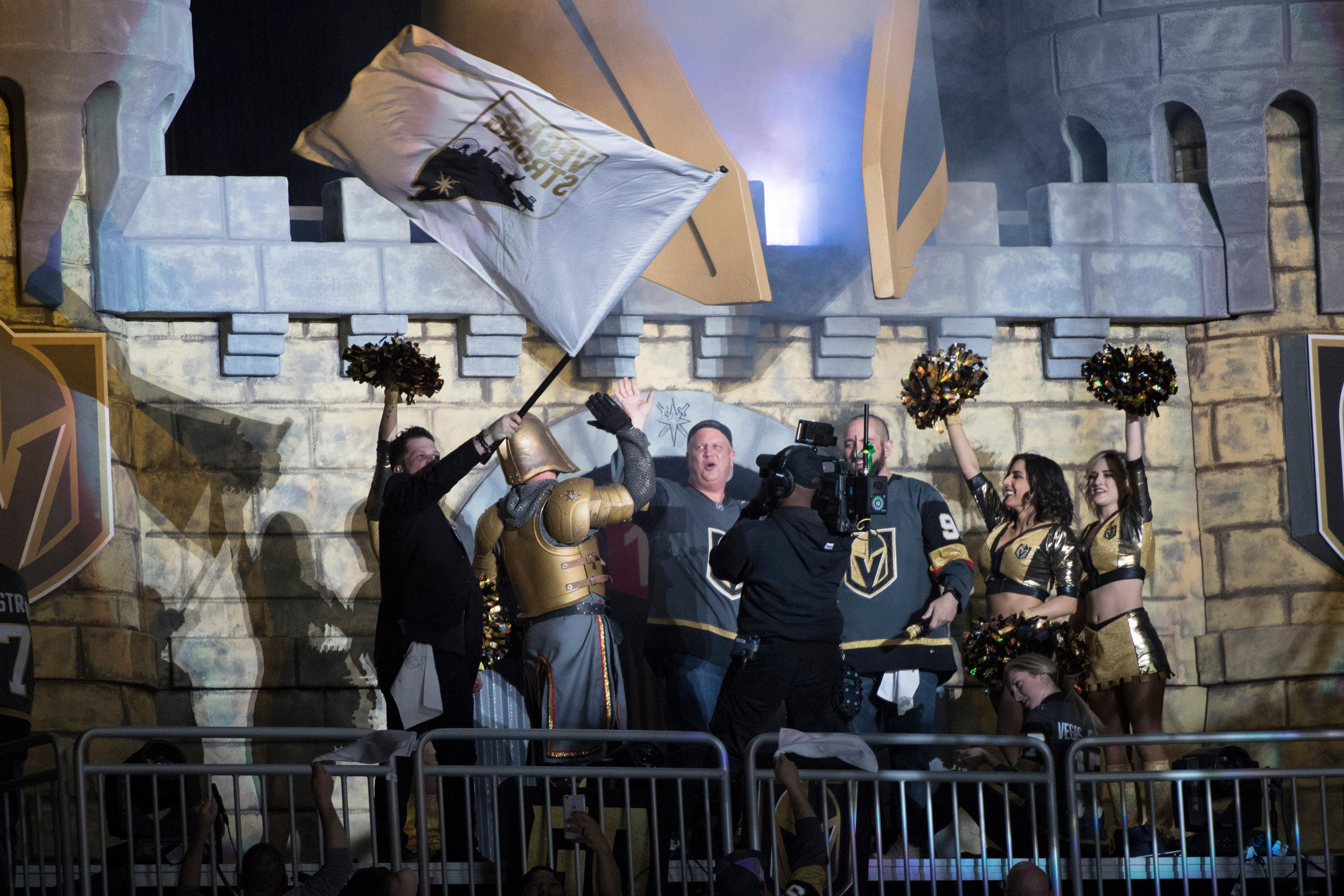 The D Las Vegas co-owner Derek Stevens gets a high five after sounding an air raid siren to start the second period of Game 1 of the NHL hockey first-round playoff series between the Vegas Golden Knights and Los Angeles Kings Wednesday, April 11, 2018 at T-Mobile Arena. The Knights won 1-0. CREDIT: Sam Morris/Las Vegas News Bureau
