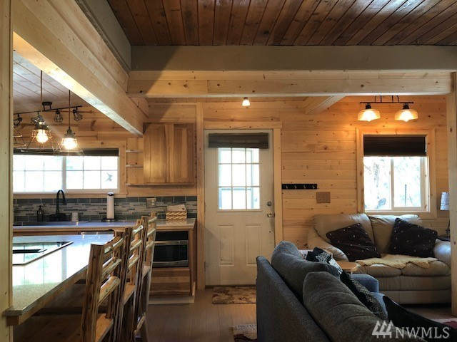 The 440 square foot beauty is listed at $229,000 and has one bedroom and 0.75 baths. The cutie little cabin is located on a secluded lot with over 300 feet of river front view! (Image: RE/MAX Legacy).