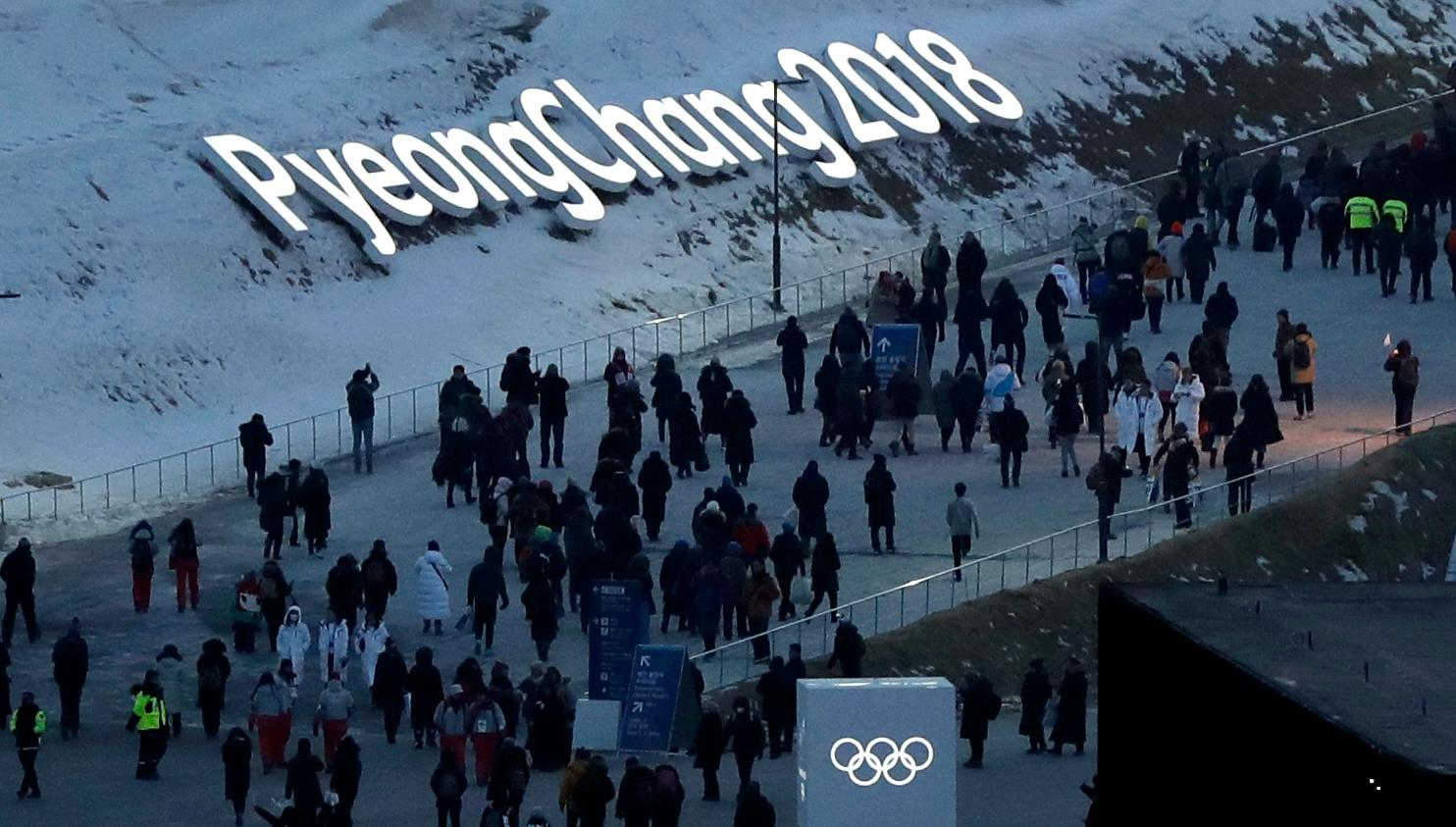 People arrive at the Olympic Stadium ahead of the opening ceremony at the 2018 Winter Olympics in Pyeongchang, South Korea, Friday, Feb. 9, 2018. (AP Photo/Kirsty Wigglesworth)