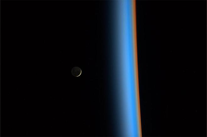 Crescent moon rising from the Earth atmosphere. (Photo & Caption courtesy Koichi Wakata (@Astro_Wakata) and NASA)