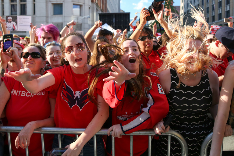 Thousands of Caps fans flooded the streets of D.C. for the fourth game of the Stanley Cup series. Tonight the Caps will face off against the Vegas Golden Knights with a 2-1 lead. The evening was kicked off with a free concert from Fall Out Boy at the National Portrait Gallery, but as soon as their show was done, the fans settled in to watch the game being livestreamed outside of Capital One Arena. (Amanda Andrade-Rhoades/DC Refined)
