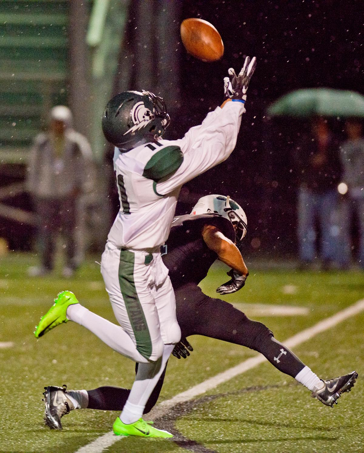 West Salem Titans wide receiver Stanley Green (#11) hauls in a long pass. On a rainy Monday evening Sheldon defeated West Salem 41-7. The game had been postponed from Friday due to unhealthy levels of smoke in the atmosphere due to nearby forest fires. Photo by Dan Morrison, Oregon News Lab