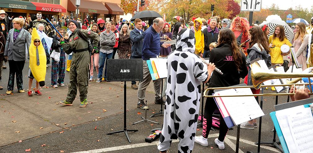 Andy Atkinson / Daily Tidings<br>The Ashland middle school band played Halloween songs for parade goers from across the street from the library.