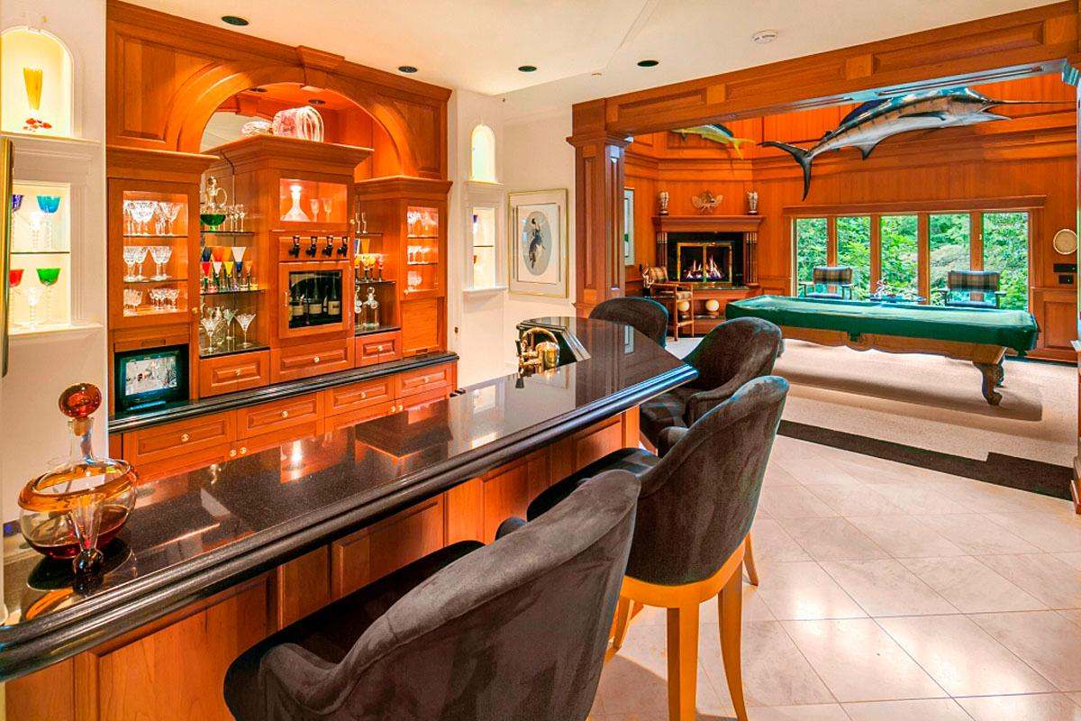 This 5 bedroom / 8.5 bath on Mercer Island is selling for $26,800,000 by Wendy Lister at Coldwell Banker Bain. The home's many amenities include an 80'main hall, full gardens, sports pavilion, private tennis court, indoor spa, vessel dock, seven room owner suite, movie theatre, billiards parlor, tap room, and a scone/tea room at waterside putting green. (Image: PC Clarity NW)