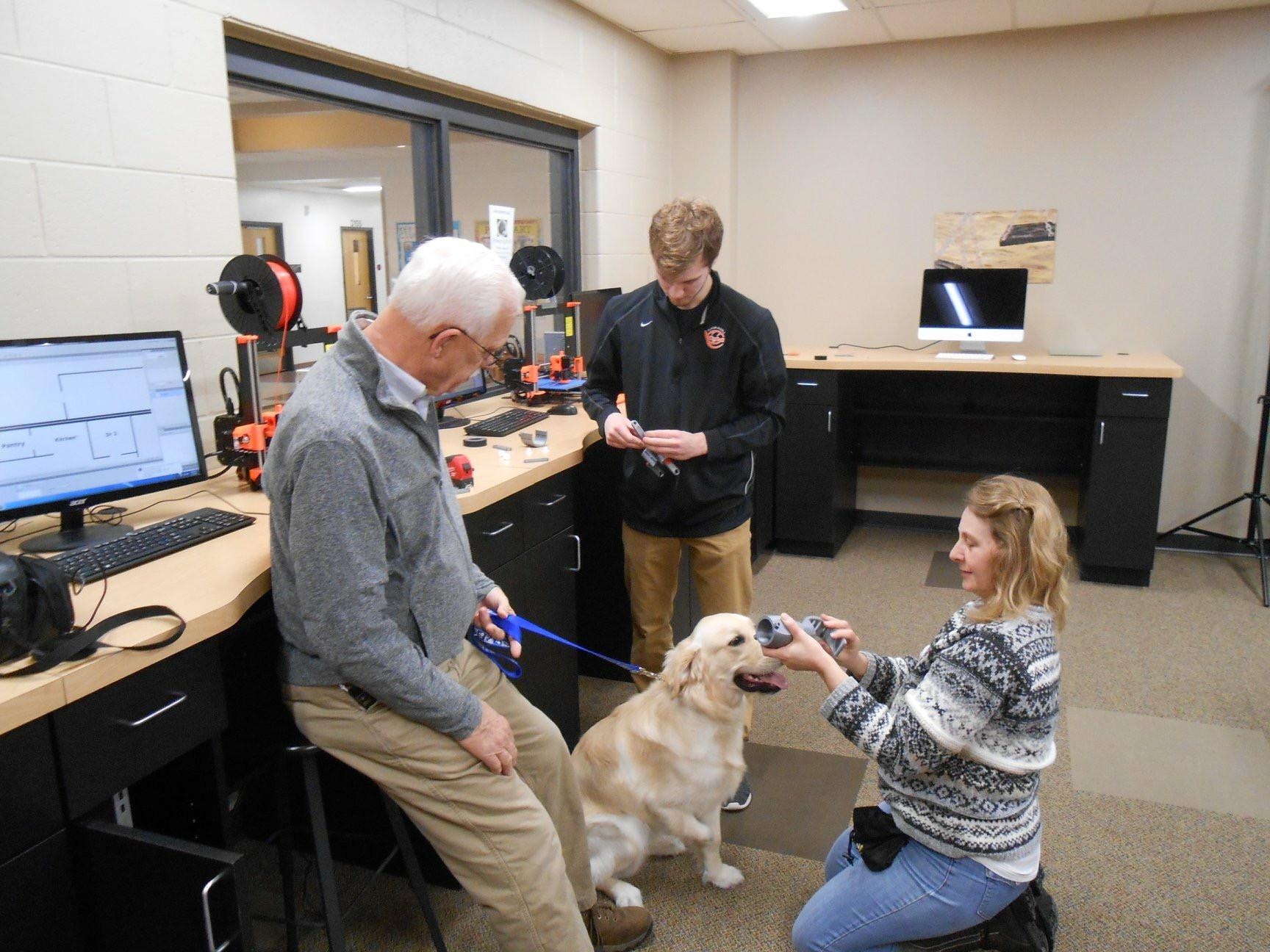 Grey the puppy is fitted with a prosthetic leg made by Kaukauna High School senior, Ben Brochtrup. (Photo courtesy of Kaukauna Area School District)