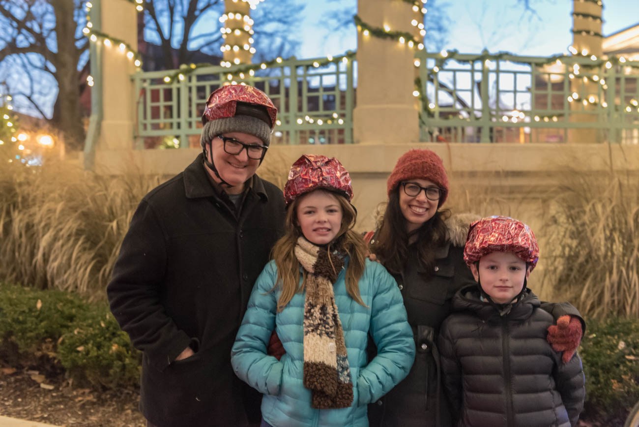The Thress Family wrapped their bike helmets in wrapping paper for the 2018 Holiday BRIGHT Ride that was held in Downtown and OTR on Saturday, December 22. / Image: Mike Menke // Published: 1.3.19