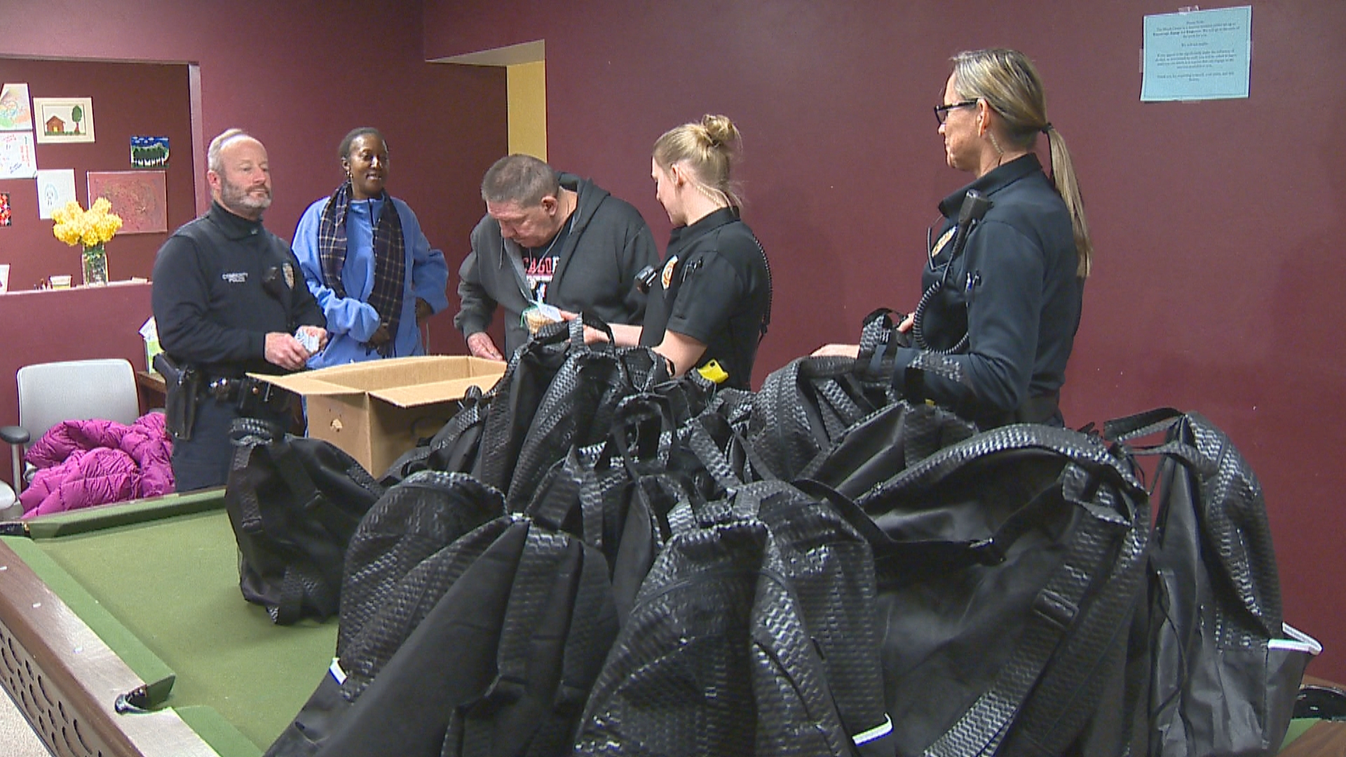 "Green Bay police officers packed up ""blessing bags"" to give out to the needy during the winter season, December 20, 2017. (WLUK)"