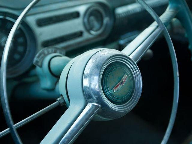The steering wheel of a 1954 Chevrolet 4-door sedan that was for sale in the auction of about 500 vintage cars and trucks from the former Lambrecht Chevrolet dealership in Pierce, Neb.