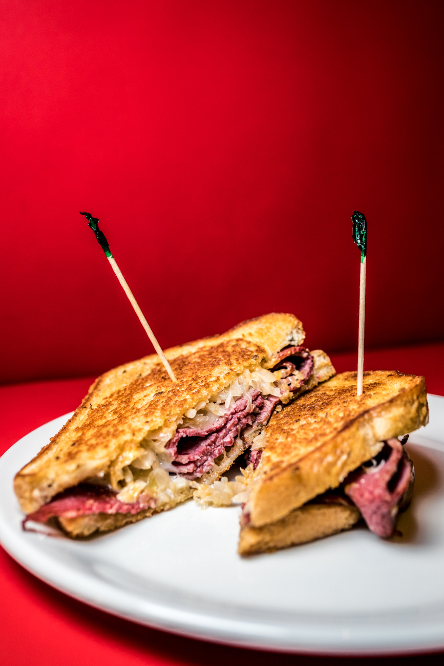 """Not So Reuben"" Reuben: oven roasted turkey, goetta, kosher salami, or ""classic"" corned beef, sauerkraut, Swiss cheese, and the special deck sauce on grilled rye bread and served with pickles / Image: Catherine Viox{ }// Published: 2.2.20"