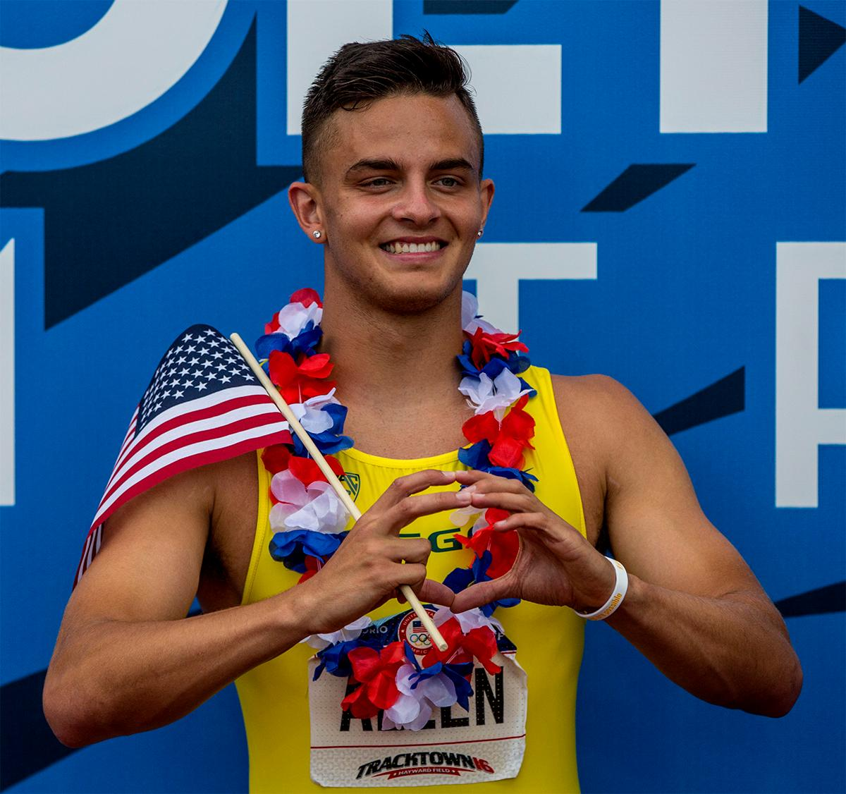 Oregon's Devon Allen throws up the Oregon's 'O' after taking victory in the 110 meter hurdles in 13.03. Photo by August Frank, Oregon News Lab