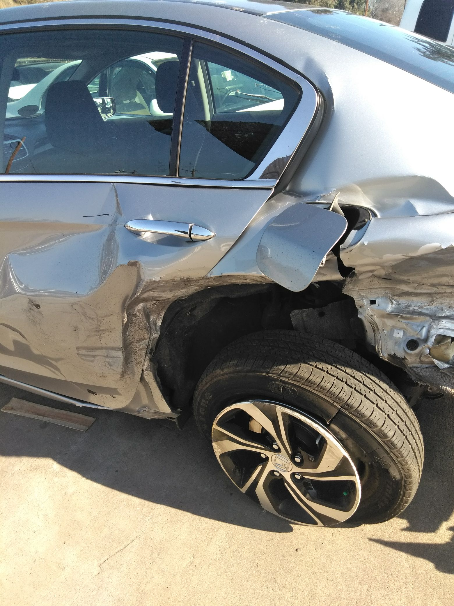 Lower left inner rear wheel detached estimated auto damages $12,000.  Courtesy Natasha Arnold.